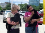 "A visitor and one of our volunteers, Cheryl, talk about and with the ""Tipton Pups"""
